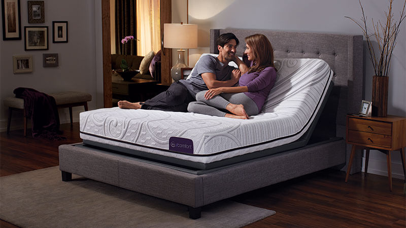 Couple using a Serta adjustable foundation